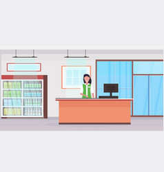 retail woman cashier at checkout counter vector image