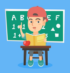 pupil sitting at the desk and pointing finger up vector image vector image
