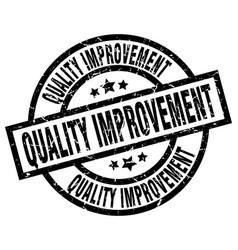 Quality improvement round grunge black stamp vector