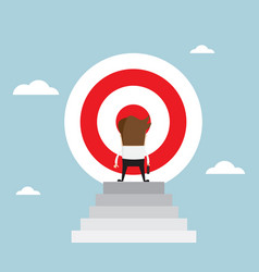 businessman standing in front of big target vector image