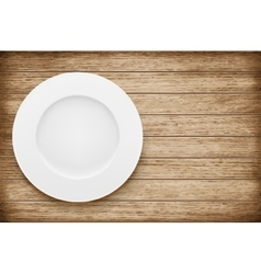 Empty plate on wooden table vector