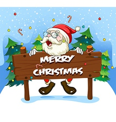 Santa Claus at the back of a wooden signboard vector