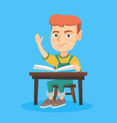 pupil raising hand while sitting at the desk vector image vector image