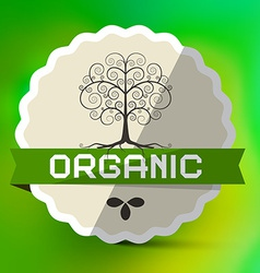 Organic Label with Tree Sign on Green Blurred vector image