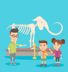 kids with a teacher studying a skeleton in museum vector image
