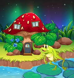 A frog jumping near the red mushroom house vector