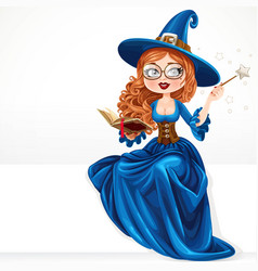 beautiful witch wearing in blue dress holding vector image