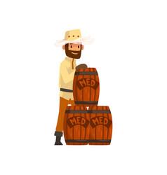 beekeeper man with wooden barrels of honey vector image