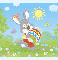 little bunny with an decorated easter egg vector image