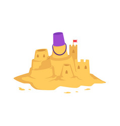 sandcastle with kid toy bucket and little red flag vector image