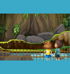 Boy and girl looking at empty cage vector