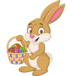 Cartoon funny rabbit holding easter basket vector