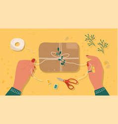 hands tying a brown box or package with string vector image