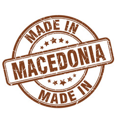 made in macedonia brown grunge round stamp vector image