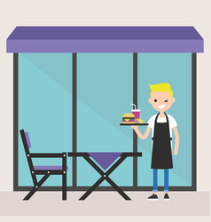 Young blonde waiter standing on the restaurant vector