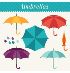 Set of cute multicolor umbrellas in flat design vector image
