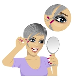 Young woman plucking her eyebrows with tweezers vector