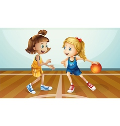 Two young ladies playing basketball vector image vector image