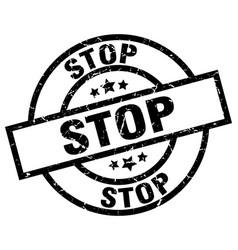 Stop round grunge black stamp vector