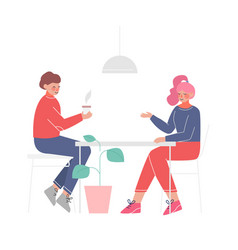 young couple sitting at table drinking coffee vector image