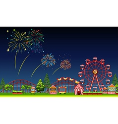 Amusement park scene at night with fireworks vector image