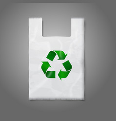 Blank white plastic bag with green recycling sign vector