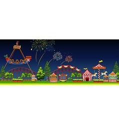 Amusement park scene at night vector image