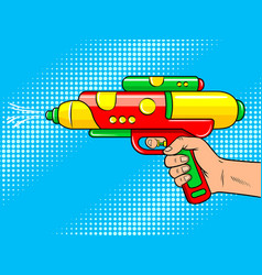 Hand with water gun pop art vector