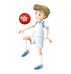 A boy using the ball with the flag of Hongkong vector image
