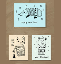 Christmas greeting cards with doodle animals vector
