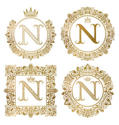 Golden letter n vintage monograms set heraldic vector