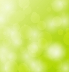 Abstract bokeh circles design on green background vector