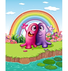 Two monsters at the riverbank with a rainbow in vector
