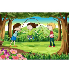 Three kids playing with a rope in the middle of vector image vector image