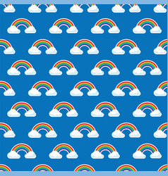 rainbow arc and white clouds in blue sky seamless vector image