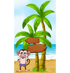 A beach with a monkey near the arrow signages vector image vector image