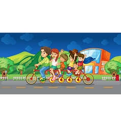 Family riding on bicycle at night vector image