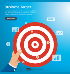 Businessman holding dartboard center goal vector