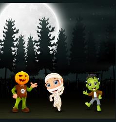 Happy kids wearing halloween costume in the garden vector