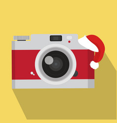 red vintage camera with red hat vector image