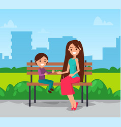 Mom and son sitting on bench in city park vector