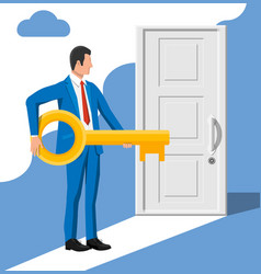 businessman in front closed door holding key vector image