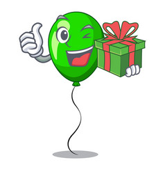 With gift green ballon with cartoon ribbons vector