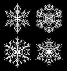 Decorative snowflakes set on black background vector