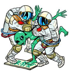 Astronauts arrested an alien green man vector