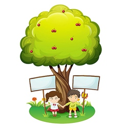 Kids under the tree with empty signboards vector image
