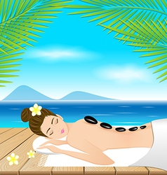 Beautiful woman lying a therapy with hot stones on vector
