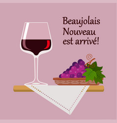 wine glass beaujolais nuvo with red grapes vector image