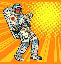 Astronaut young man points african american vector
