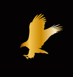 Golden silhouette of eagle isolated on blac vector